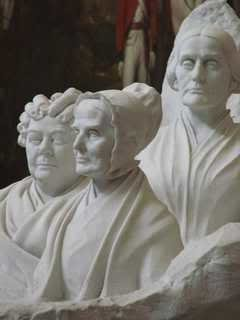 portrait busts of early women's rights leaders Stanton, Mott and Anthony