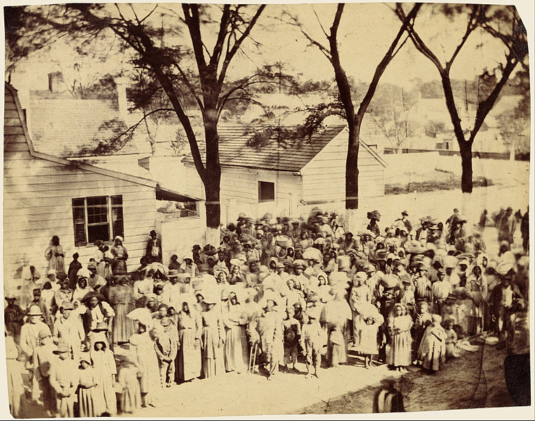 Southern civilians with their slaves in line to receive rations from the Union Army during the Civil War in Beaufort, South Carolina.