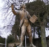 bronze statue of Thomas Paine in England